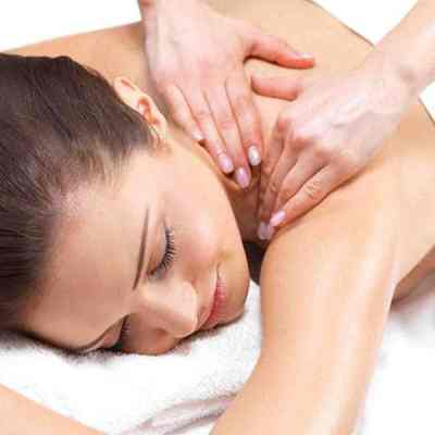 CIBTAC Massage Diploma in Swedish Body Massage. A practitioner kneading customer's shoulder