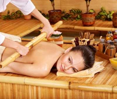 Young woman getting bamboo massage.