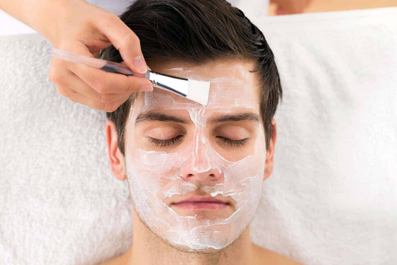 A man receiving facial treatment