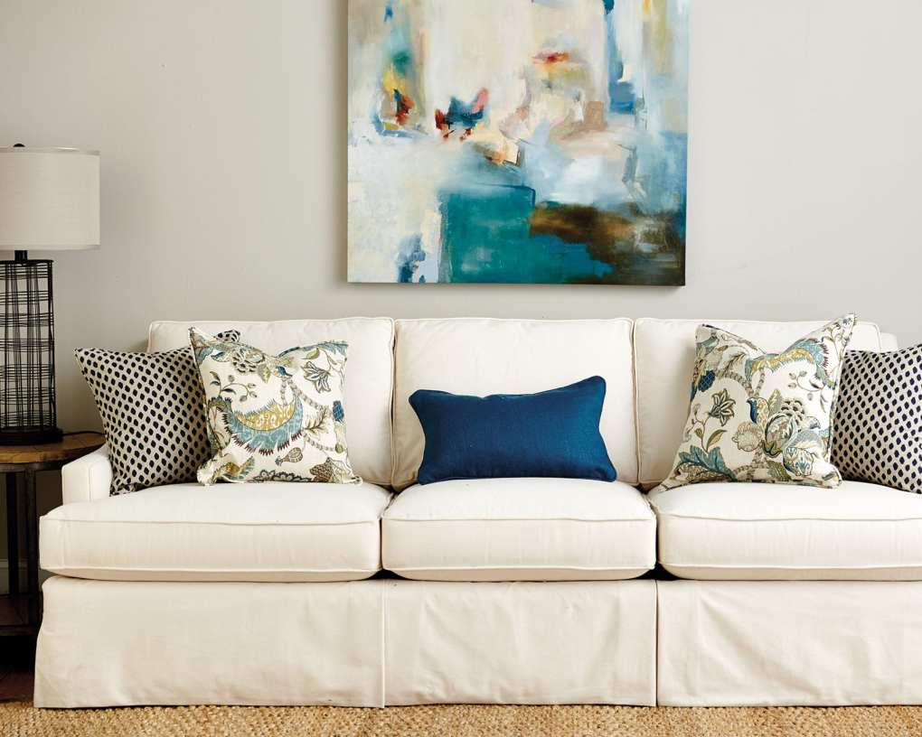 Blue throw pillows on an off-white couch