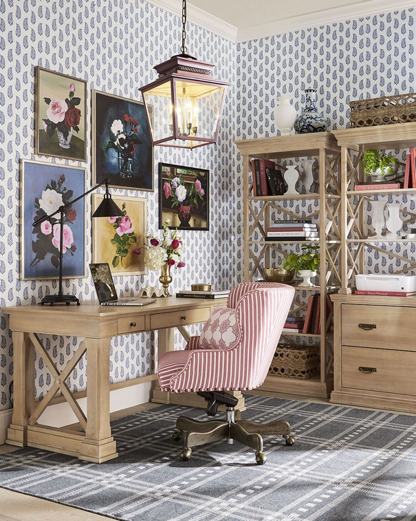 Home office with wallpaper and striped desk chair