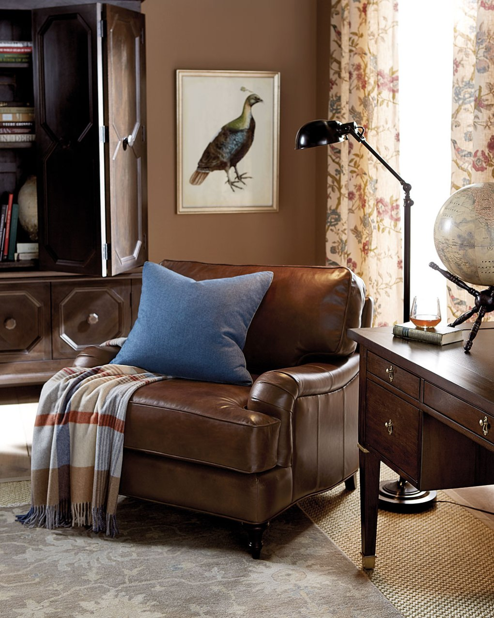 A chocolate colored leather furniture chair in a living room