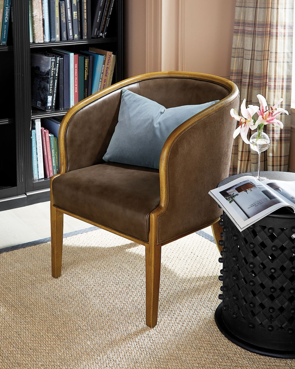 A small scaled rounded leather furniture chair in a living room