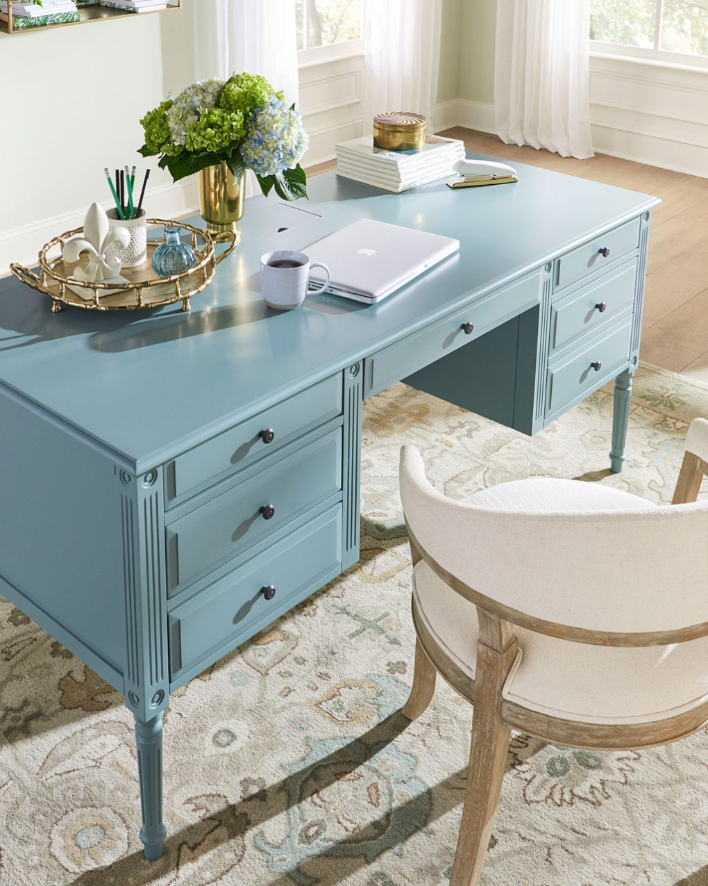 Create a work from home setup with an expansive desk surface from Ballard Designs