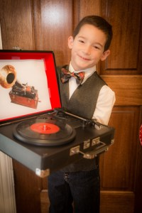 """Here's my little Thomas Edison heading off to school with his portableCrosley """"phonograph""""for his presentation prop."""