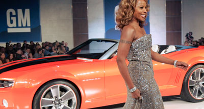 Singer Mary J. Blige walks the runway with a 2009 Camaro Convertible at the GM TEN fashion event Tuesday, February 20, 2007 in Los Angeles, California.