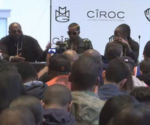 Rick Ross alongside MMG artists Omarion and Wale