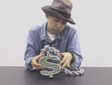 NIGO Shows Off Massive Dollar-Sign Chain