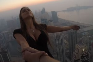 Model Viki Odintcova Dangle From Dubai's Cayan Tower