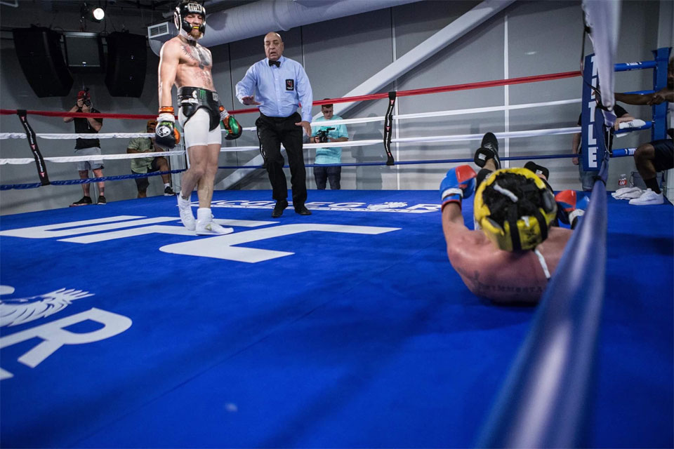 Paulie Malignaggi knocked down by Conor McGregor