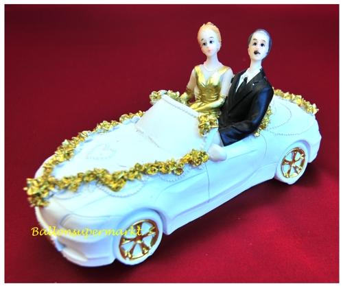 Hochzeitsdekoration Brautpaar im Hochzeitsauto gold