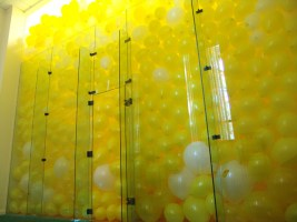 racquet ball court filled with balloons