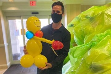 Tommy holding a balloon buddy