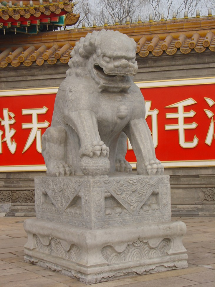 A lion statue in front of a administration building