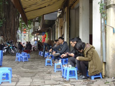 People drinking tea at the street in the morning.