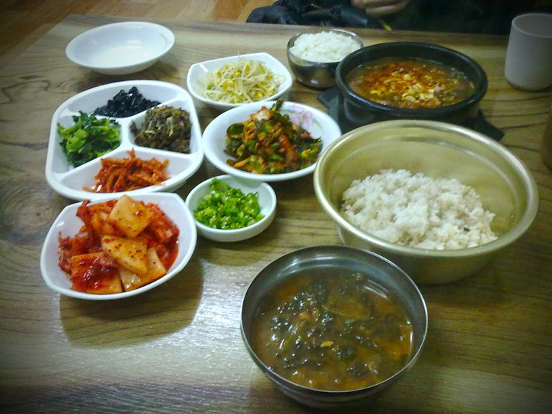 Jjigae (찌개) with side dishes and rice.
