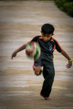 Daily life in Bario: Child playing with football. (Sarawak, Malaysia)