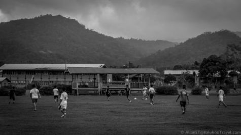 Daily life in Bario: Locals playing soccer on a field next to the school. (Sarawak, Malaysia)