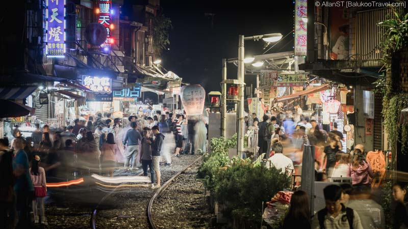 Visitors releasing sky lanterns on railway track. (Shifen Old Street, Taiwan) @2016