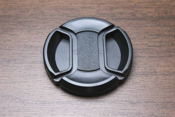 49mm lens cap front