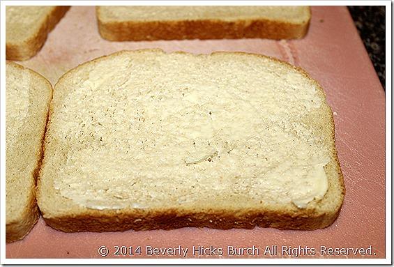 Lightly spread butter onto bread