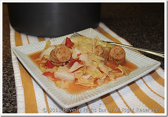 Plated Sauted Cabbage with Tomatoes and Sausage