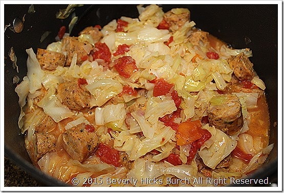 Sauted cabbage with tomatoes and sausage