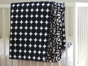 black dots and numbers beding by quilt baby