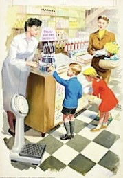 Little boy choosing his toothbrush in the chemist