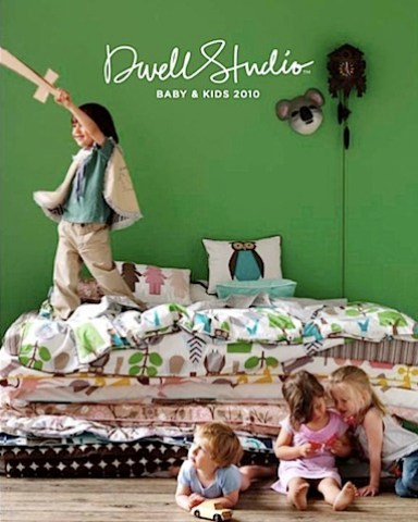 dwell studio 2010 collection showing kids jumping on the bedding