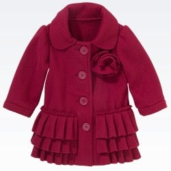 Main Range red wool coat with flower corsage and frill detail
