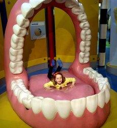 Tabitha inside a mouth at Eureka!