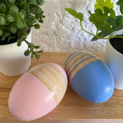 pink and blue egg rattles