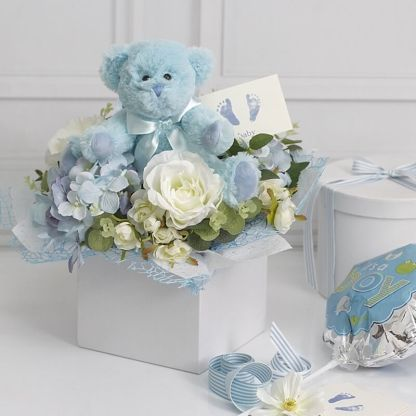 bear with flowers baby blue 25cm