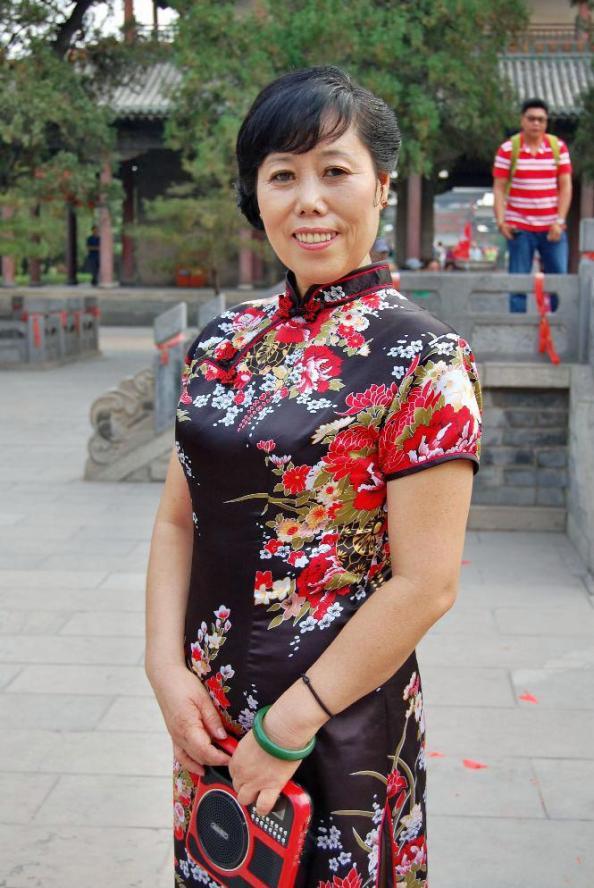 Chefin im Qipao