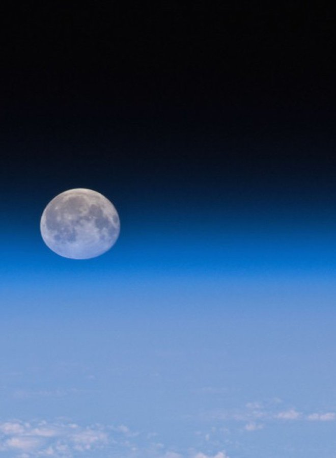 The Moon, as seen partially through the Earth's atmosphere.