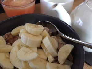 Porridge, brown sugar, milled linseed, almond butter, almond milk and banana. Delicious!