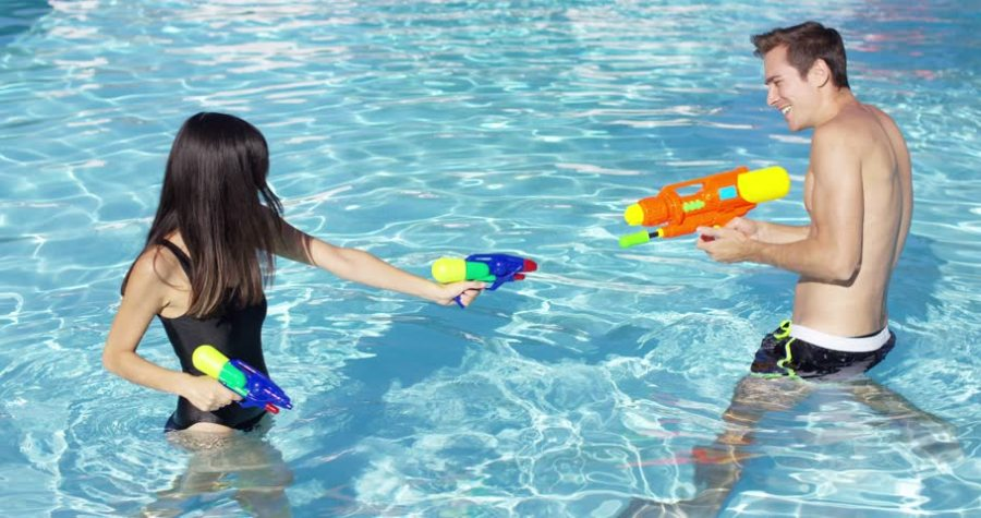 Playing with water guns.