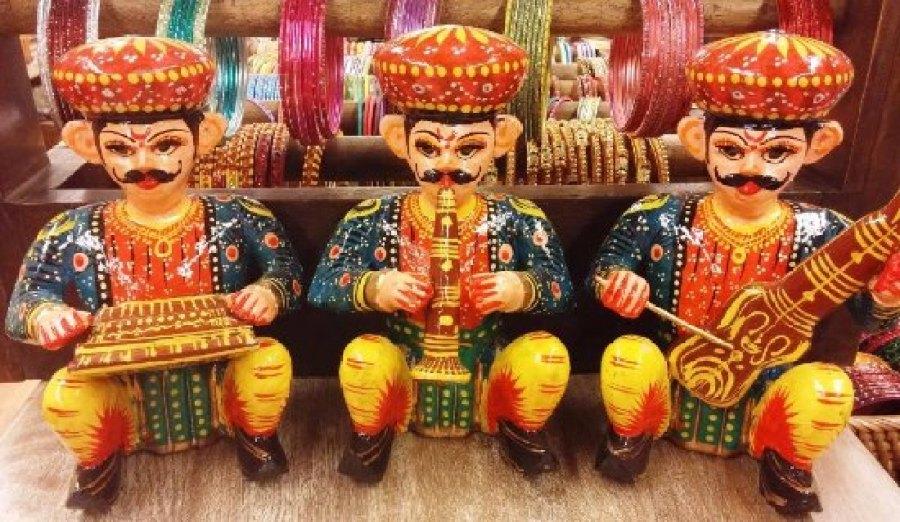 Wooden handicrafts depict village life