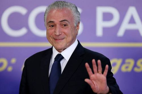 Brazil's President Michel Temer waves during a ceremony at the Planalto Palace in Brasilia