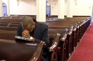 Man praying in church - small