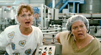 Beth Grant and Lidia Porto. If I told you this was a photo of actual factory workers, wouldn't you believe me?