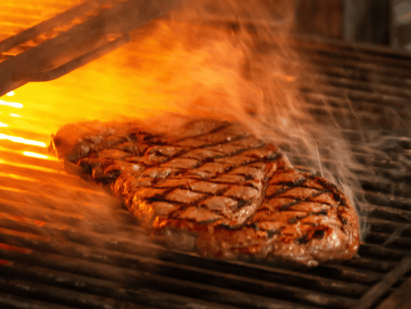 Beef Grilling in a Charcoal Grill