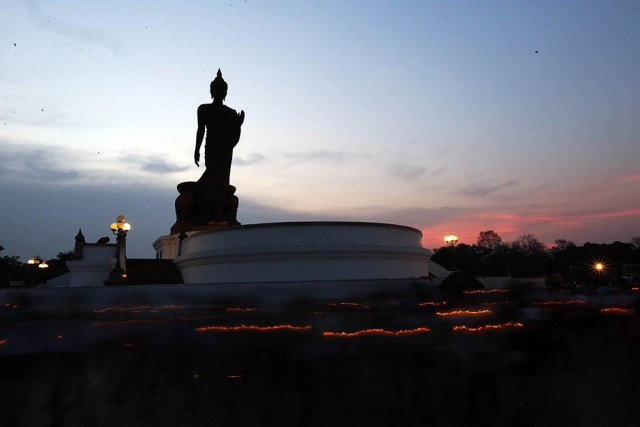 Buddhist monks and followers meditate, chant and circle around temples, Buddha statues and stupas across Thailand during ceremonies celebrating Makha Bucha Day on March 4, 2015.