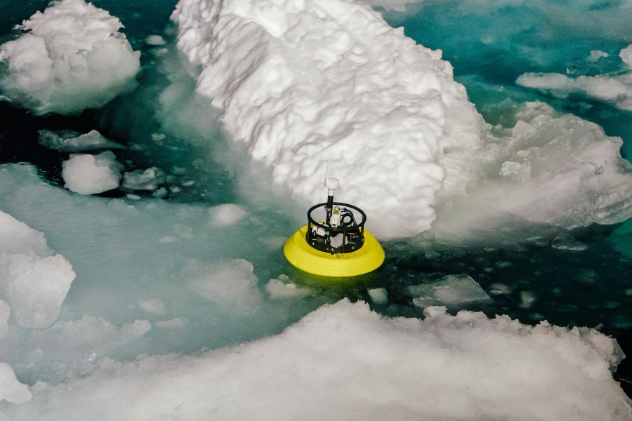 Scientific equipment seen in the water next to a piece of ice berg