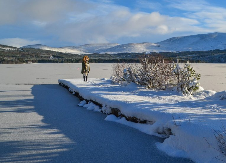 Frozen Loch Morlich. Scotland Road Trip in Scottish Highlands in Winter Snow