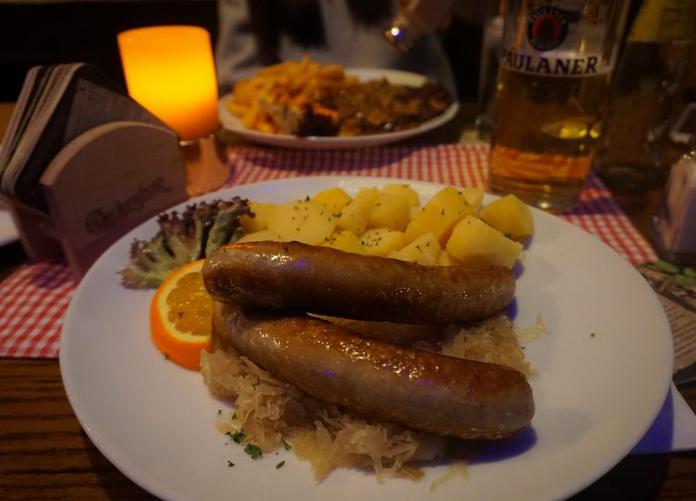 German bratwurst with sauerkraut, Interrail in Winter: Train Travel in Europe Itinerary