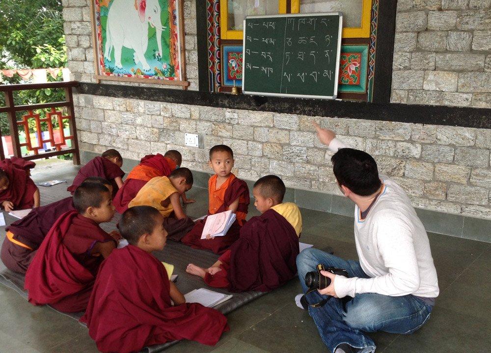Allan Wilson with Tibetan Monks in Himalayas. Bangor Travel Blogger
