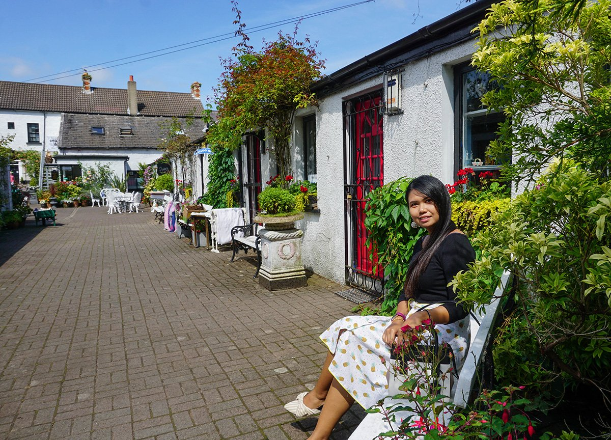 Fanfan Wilson Travel Blogger in Hoops Courtyard Greyabbey
