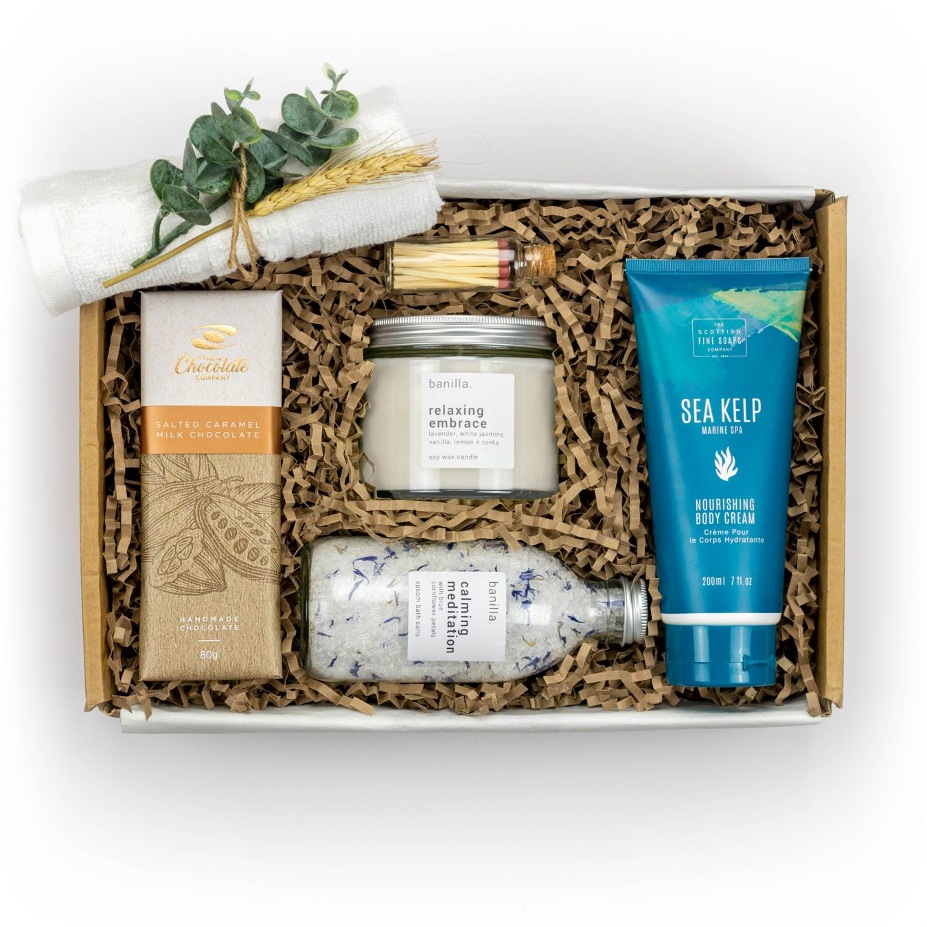 Feel Good Gift box main image with body cream, candle, bath salts, chocolate bar